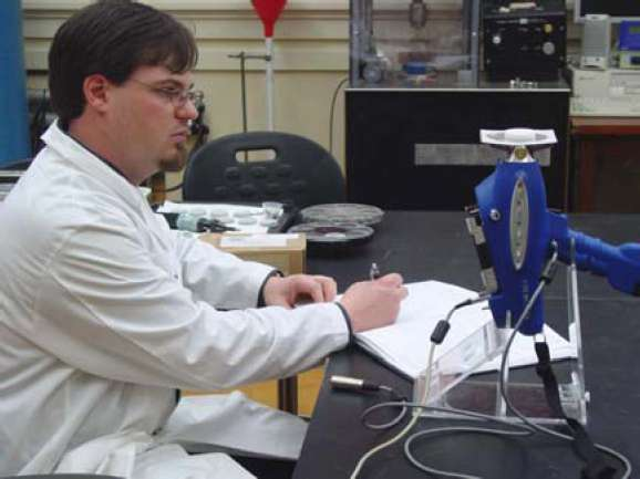Figure 12. Jason Church uses the XRF spectrometer to analysis a marble sample after artificial weathering.