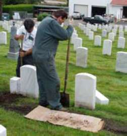 Figure 14. NCA staff members Genaro Ocrato and Pat Meyer help set sample stones at San Francisco National Cemetery.