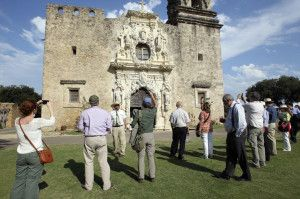 Stone carver Ivan Myjer addresses US/ICOMOS Symposium participants at Mission San Jose, San Antonio, TX.