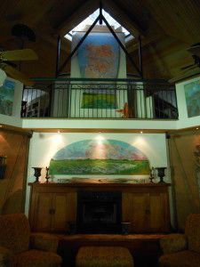 Architect Eddie Cazayoux's living room, with a ventilation cupola and bousillage walls. Photo From: Stephanie Byrd