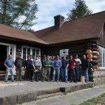 Participants pause for a group photo during a 2011 log building preservation workshop at the Pine Mountain Settlement School.