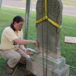 Using a tripod hoist to reset a marble headstone