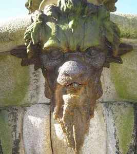 Detail of one of four cast iron masks on the middle basin.