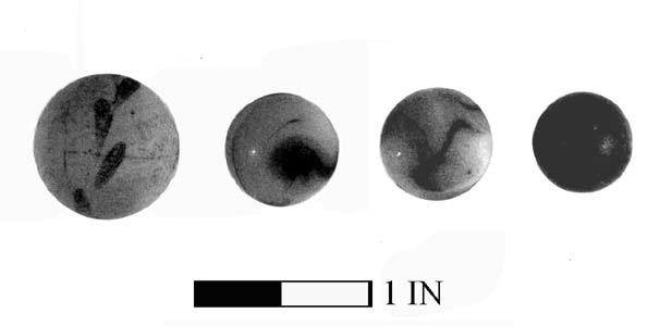 Figure 39 - Clay (far left) and glass marbles.