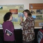 Mary Striegel and Jennifer Mass discuss research at the poster session