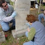 Myles Bland and Debbie Smith apply a fill patch to a repaired stone. Photo: Jason Church.