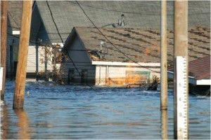 Flood water and gas fire in New Orleans after Hurricane Katrina. Photo: FEMA.