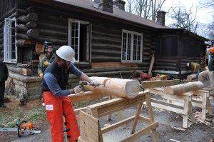 Ed FitzGerald films a worker notching a log during a workshop in Putney, KY.