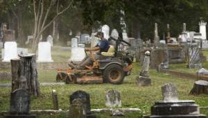 mowing in cemetery