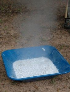 Quicklime slaking after water was added to the pan.  Steam rising above the pan was created by the exothermic reation of the quicklime slaking.