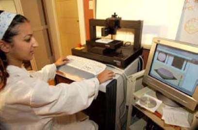 Figure 15. Researcher scans surface of stone using laser profilometer to determine texture parameters and 3-d profile.