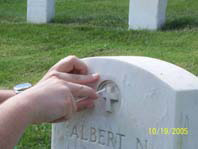 Figure 3. Photographic detail showing an acetate template being used as a guide for swabbing the headstone.