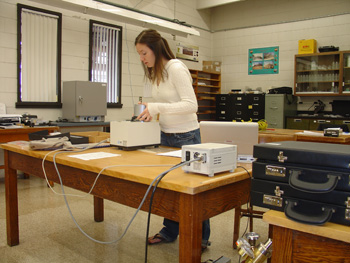 Researcher takes magnetic measurements in the laboratory