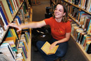 Student in the library stacks