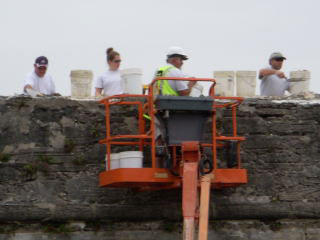 Workers repairing a fort wall