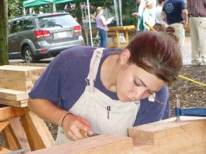 A student cleans a lap joint during the Cannon Carriage Workshop held at the PTN conference in Charleston, SC.