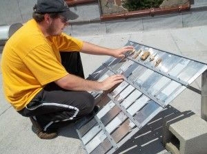 Summer intern Dennis Gibson places samples on a newly constructed exposure rack