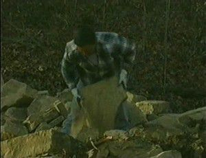 Sort through the rock supply to separate tie rocks and capstones.