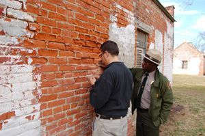 Andy Ferrell and Eric Ford discussing the slave/tenant cabins at Magnolia Plantation.