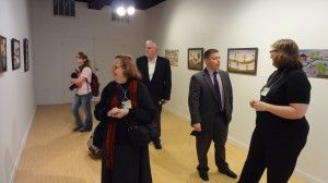 Conference participants view the collection of Clementine Hunter originals and Toye forgeries at the Gallery 2 showing