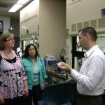 Derek Patton discusses the POSS system with NCPTT Scientists during a visit to USM