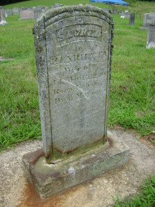 Soapstone marker showing scratches from mower.