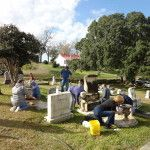 Participants clean marble headstone during the December workshop.