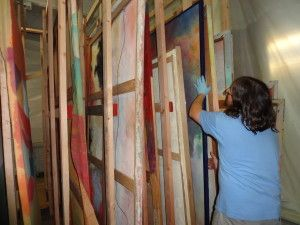 Materials Conservator Jason Church loads a newly constructed paintings rack with water damaged canvas