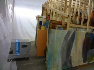 Water damaged paintings by Landfield await assessment at the CRC