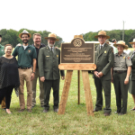 Representative from the National Park Service and Louisiana SHPO Pam Breaux pose with the newly unveiled Poverty Point World Heritage Site plaque.