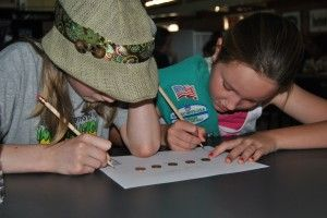 Juniors chart the age of their pennies.