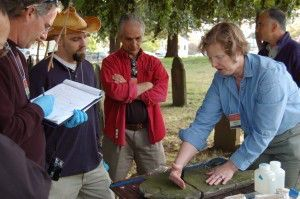 Participants in NCPTT's cemetery workshop learn how to repair a slate gravemarker.