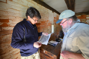 Rudy explains to Andy Ferrell what the cut marks show in a rubbing of a timber.