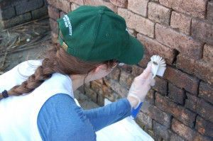 Katherine Langdon at Fort Livingston testing cleaning methods on oil-contaminated bricks.