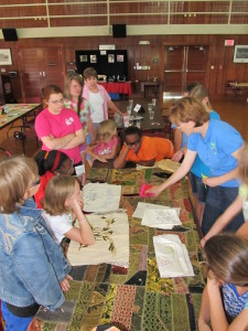 Debbie Smith discusses the construction of heirloom textiles with campers.