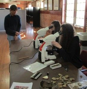 Regional Archaeologist Jeff Girard shows students thin sections of Native American Pottery.