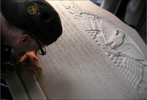 Carving the succeessor monument.