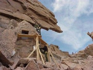 Historic preservation crew completes work on the Agnes Vaille Shelter historic structure at the Keyhole on Longs Peak, Rocky Mountain National Park Wilderness.