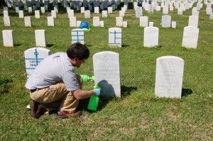 Jason Church tests cleaning solutions on headstones at Alexandria National Cemetery, Pineville, LA.