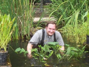 NPS Ranger inspects aquatic plants.
