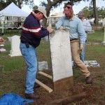 Participant Stan Rogers helps instructor Karl Munson remove a stone for resetting. Photo: Jason Church.