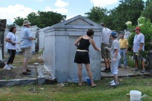 Participants limewashing mausoleum at Lafayette Cemetery No. 1 in New Orleans, La. during the Limewash Workshop on June 13, 2009