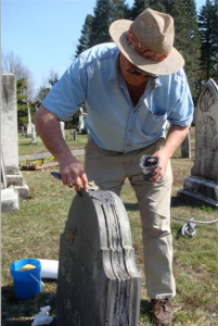 Irving Slavid applies a fill to a delaminated slate.