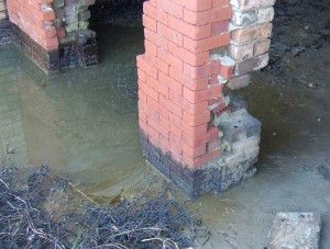 Figure 1. The brick face of the nearer column was re-contaminated. Additional sand was deposited in this area.