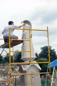 NCPTT Conservator Jason Church looks at deposits of gypsum crusts on the Macomb monument.