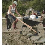 "The Symposium will include the Third Lithic Olympic Games, including such events as a dry stone walling competition and a ""wheelbarrow steeplechase"" (seen above). Photo curtosey of The Stone Foundation."